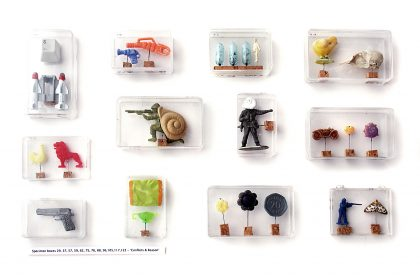 'Conflicts & Reason', 2002-2009. Found beach plastic, steel pins, cork, plastic boxes & text.